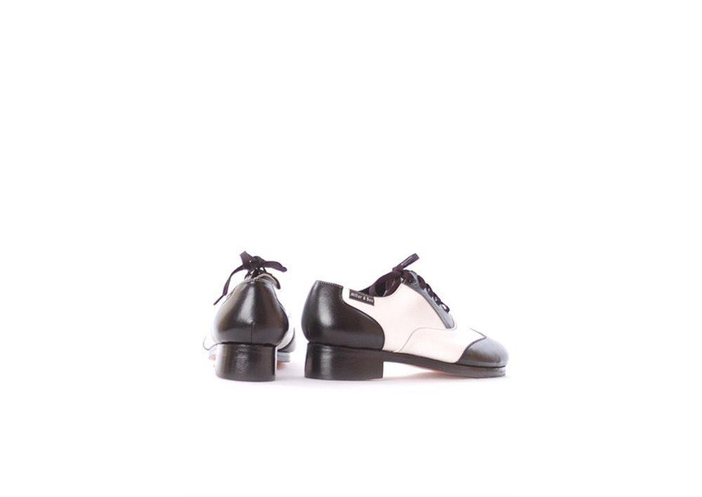 zapatoclaque blanco-negro